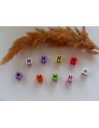 Бусины квадратные цветные со знаками зодиака. Рыбы